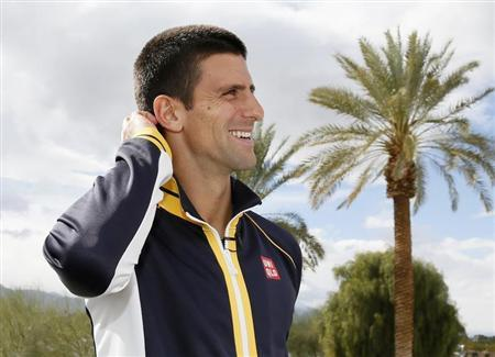 Novak Djokovic of Serbia ponders a trivia question about a fellow tennis player while he is interviewed at the BNP Paribas Open ATP tennis tournament in Indian Wells, California, March 8, 2013. REUTERS/Danny Moloshok
