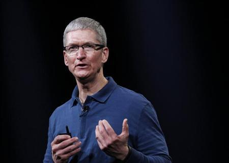 Apple CEO Tim Cook speaks to the audience during an Apple event in San Jose, California October 23, 2012. REUTERS/Robert Galbraith/Files