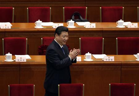 China's Communist Party Chief Xi Jinping arrives for a plenary session of the National People's Congress (NPC) at the Great Hall of the People, in Beijing March 8, 2013. REUTERS/Jason Lee