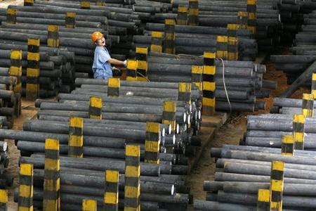 An employee works at the Zhongshi Special Steel Tube Co. Ltd in Xianning, in central China's Hubei province September 13, 2007. REUTERS/Stringer