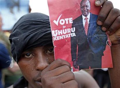 A supporter of presidential candidate Uhuru Kenyatta celebrates on the outskirts of Nairobi March 9, 2013. REUTERS-Goran Tomasevic