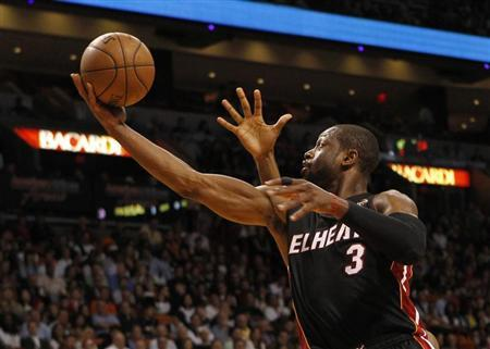 Miami Heat guard Dwyane Wade scores a basket against the Orlando Magic during their NBA basketball game at the American Airlines Arena in Miami, Florida, March 6, 2013. REUTERS/Robert Sullivan