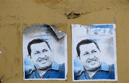 Posters of Venezuela's late President Hugo Chavez are seen in a street of Caracas, March 9, 2013. REUTERS/Mariana Bazo