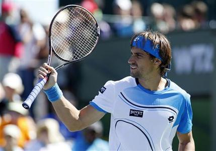 David Ferrer of Spain reacts after winning a point against Kevin Anderson of South Africa during their match at the BNP Paribas Open ATP tennis tournament in Indian Wells, California, March 9, 2013. REUTERS/Danny Moloshok