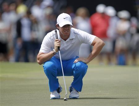 Northern Ireland's Rory McIlroy looks at his putt on the ninth green during the third round of play in the 2013 WGC-Cadillac Championship PGA golf tournament in Doral, Florida March 9, 2013. REUTERS/Andrew Innerarity