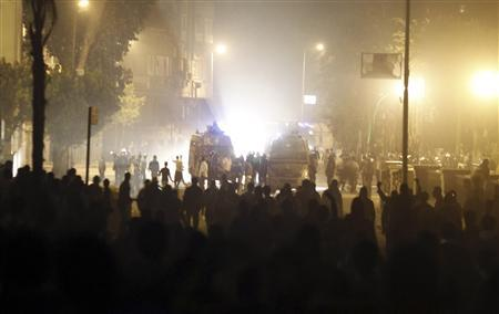 Protesters, who oppose Egyptian President Mohamed Mursi, face riot police during clashes along Qasr Al Nil bridge, which leads to Tahrir Square in Cairo March 9, 2013. REUTERS/Amr Abdallah Dalsh