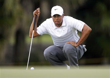 Tiger Woods lines up a putt on the 13th green during third round play in the 2013 WGC-Cadillac Championship PGA golf tournament in Doral, Florida March 9, 2013. REUTERS/Andrew Innerarity