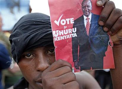 A supporter of presidential candidate Uhuru Kenyatta celebrates on the outskirts of Nairobi March 9, 2013. REUTERS/Goran Tomasevic