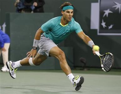 Rafael Nadal of Spain hits a return against Ryan Harrison of the U.S. during their match at the BNP Paribas Open ATP tennis tournament in Indian Wells, California, March 9, 2013. REUTERS/Danny Moloshok