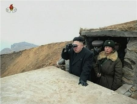 North Korean leader Kim Jong-un looks through a pair of binoculars at an undisclosed location, in this still image taken from video shown by North Korea's state-run television KRT on March 8, 2013. REUTERS/KRT via Reuters TV