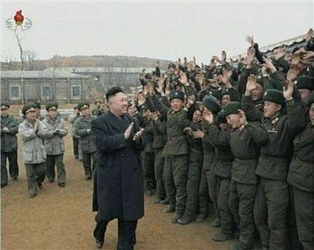 North Korean leader Kim Jong-un (front on L) applauds as he is welcomed by members of the military at an undisclosed location, in this still image taken from video shown by North Korea's state-run television KRT on March 8, 2013. REUTERS/KRT via Reuters TV
