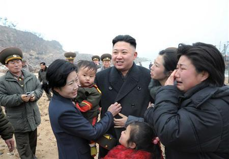 Residents greet North Korean leader Kim Jong-Un (C) during his visit to the Jangjae Islet Defence Detachment and Mu Islet Hero Defence Detachment on the front, near the border with South Korea, southwest of Pyongyang March 7, 2013 in this picture released by the North's official KCNA news agency in Pyongyang March 8, 2013. REUTERS/KCNA