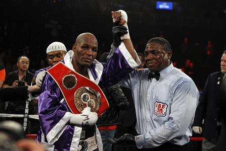 Bernard Hopkins (L) poses for a photo with referee Earl Brown after defeating Tavoris Cloud in their IBF light heavyweight title in New York March 9, 2013. REUTERS/Adam Hunger