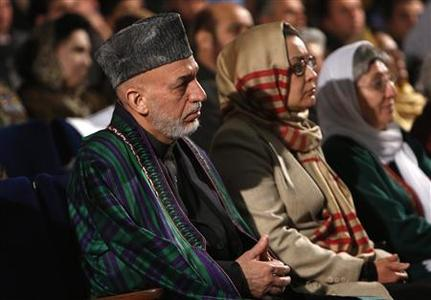 Afghan President Hamid Karzai sits during an event to mark International Women's Day in Kabul March 10, 2013. REUTERS/Mohammad Ismail