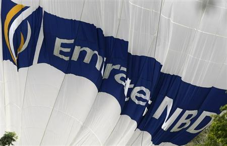 The logo for Emirates NBD bank is seen on a deflating hot air balloon over the Emirates Golf Course in Dubai December 11, 2009. REUTERS/Steve Crisp