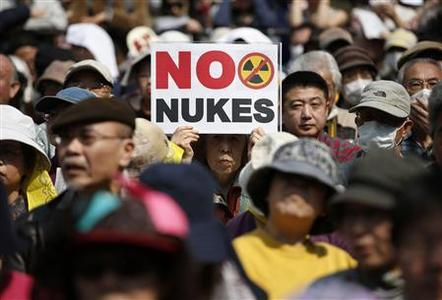 Anti-nuclear protesters attend a rally in Tokyo March 10, 2013, a day before the second-year anniversary of the March 11, 2011 earthquake and tsunami that killed thousands and set off a nuclear crisis. On March 11, 2013, Japan will mark two years since the disaster which set off a radiation crisis that shattered public trust in atomic power and the nation's leaders. REUTERS/Issei Kato