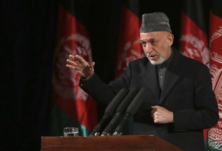 Afghan President Hamid Karzai gives a speech during an event to mark International Women's Day in Kabul March 10, 2013. REUTERS/Mohammad Ismail