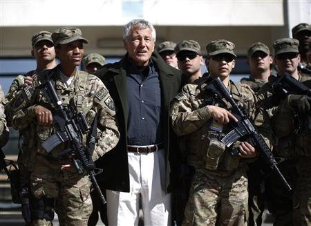 U.S. Secretary of Defense Chuck Hagel (C) poses for a picture with members of the U.S. Army and Marines during his visit to the Kabul Military Training Center in Kabul March 10, 2013. REUTERS/Jason Reed