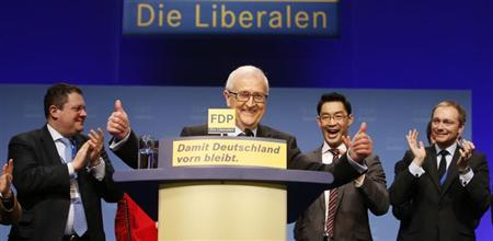 Faction leader of the liberal Free Democratic Party (FDP) Rainer Bruederle (C) reacts after his speech during a two-day party convention in Berlin March 10, 2013. REUTERS/Tobias Schwarz