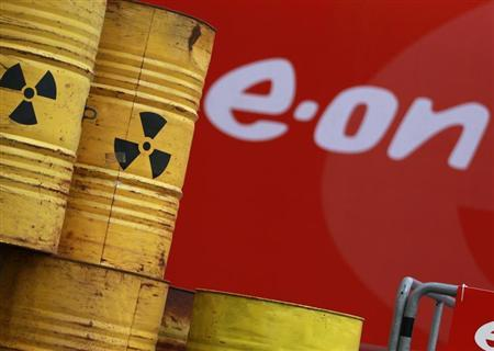 Mock-ups of atomic waste barrels are arranged by protestors at the entrance of the annual meeting of German utility giant E.ON in Essen May 3, 2012. REUTERS/Ina Fassbender