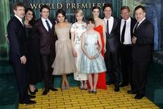 """(From L-R) Walt Disney Studios Chairman Alan Horn, actress Abigail Spencer, actor James Franco, actresses Mila Kunis, Michelle Williams, Joey King, Rachel Weisz, actor Zach Braff, producer Joe Roth and director Sam Raimi pose for a picture at the premiere of the Disney movie """"Oz the Great and Powerful"""" at the El Capitan Theatre in Hollywood, California February 13, 2013. REUTERS/Patrick Fallon"""