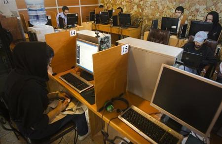 Customers use computers at an internet cafe in Tehran May 9, 2011. REUTERS/Raheb Homavandi