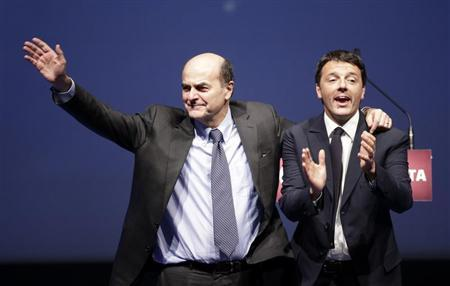 Italian PD (Democratic Party) leader Pierluigi Bersani (L) waves next to mayor of Florence Matteo Renzi during a political rally in Florence February 1, 2013. REUTERS/Max Rossi