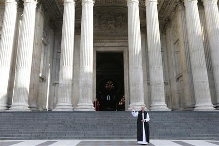 Justin Welby, the new Archbishop of Canterbury, stands in front of St Paul's Cathedral following a ceremony, London February 4, 2013. REUTERS/Andrew Winning