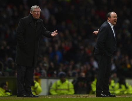 Manchester United's manager Alex Ferguson (L) gestures as Chelsea's interim manager Rafael Benitez shouts during their English FA Cup quarter-final soccer match at Old Trafford in Manchester, northern England, March 10, 2013. REUTERS/Russell Cheyne