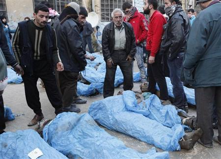 Residents attempt to identify bodies found along a river, at a school used as a field hospital in Aleppo's Bustan al-Qasr January 29, 2013. At least 65 people, apparently shot in the head, were found dead with their hands bound in a district of the northern Syrian city of Aleppo. REUTERS/Zain Karam