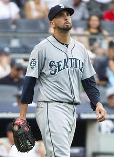 Seattle Mariners relief pitcher Oliver Perez reacts after he gave up a two-run single to New York Yankees batter Raul Ibanez in the sixth inning of their MLB American League game at Yankee Stadium in New York, August 5, 2012. REUTERS/Ray Stubblebine