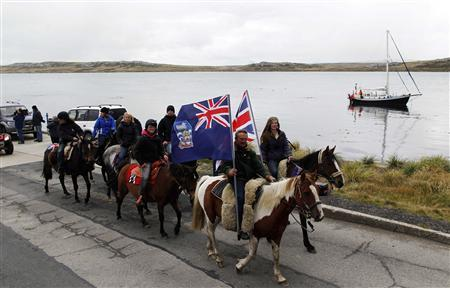 Falkland islanders ride their horses during a parade in Stanley, March 10, 2013. REUTERS/Marcos Brindicci
