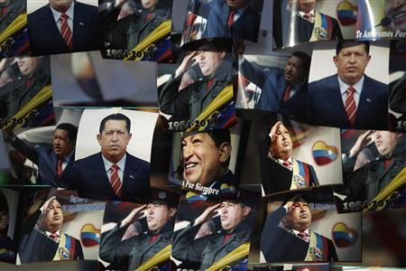 Photos of the late President Hugo Chavez are hung out for sale outside of the Military Academy, where the funeral service of Chavez is being held, in Caracas, March 10, 2013. REUTERS/Jorge Dan Lopez
