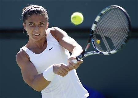 Sara Errani of Italy hits a returns to Johanna Larsson of Sweden during their match at the BNP Paribas Open WTA tennis tournament in Indian Wells, California, March 10, 2013. REUTERS/Danny Moloshok