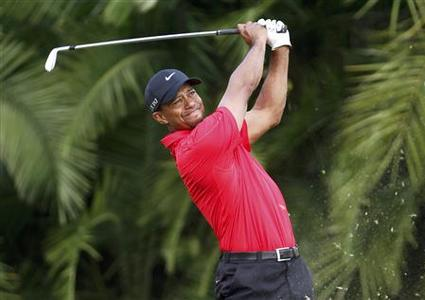 Tiger Woods watches his tee shot on the 16th hole during final round play in the 2013 WGC-Cadillac Championship PGA golf tournament in Doral, Florida March 10, 2013. REUTERS/Andrew Innerarity