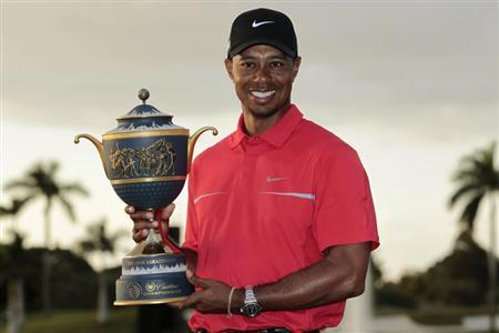 Tiger Woods poses with the Gene Sarazen Trophy after winning the 2013 WGC-Cadillac Championship PGA golf tournament in Doral, Florida March 10, 2013. REUTERS/Joe Skipper