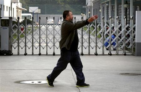 Dissident Chinese artist Ai Weiwei reacts as he walks into the Chaoyang District Court to attend his appeal verdict hearing in Beijing September 27, 2012. REUTERS/David Gray/Files