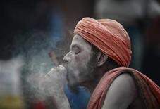 A sadhu (Hindu holy man) smokes marijuana on the premises of Pashupatinath Temple during the Shivaratri festival in Kathmandu March 10, 2013. REUTERS/Navesh Chitrakar