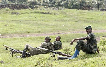 M23 rebel fighters guard the venue of a news conference in Bunagana in eastern Democratic Republic of Congo January 3, 2013. REUTERS/James Akena