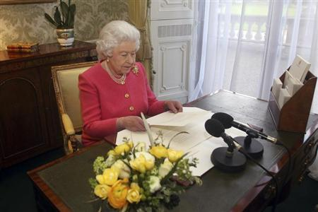 Queen Elizabeth reads out her Commonwealth Day message at Buckingham Palace in central London in this photograph taken in February and officially released on March 11, 2013. REUTERS/Lewis Whyld/Pool