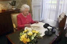 "Britain's Queen Elizabeth reads out her Commonwealth Day message at Buckingham Palace in central London in this photograph taken in February and officially released on March 11, 2013. In her annual address, the Queen highlighted this year's Commonwealth theme ""Opportunity Through Enterprise"". REUTERS/Lewis Whyld/Pool"