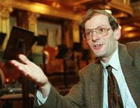 Clemens Hellsberg, violonist and president of the Vienna Philharmonic Orchestra gestures during an interview with Reuters in the Musikverein, Vienna's resplendent golden music hall July 1, 1998. LF/GB