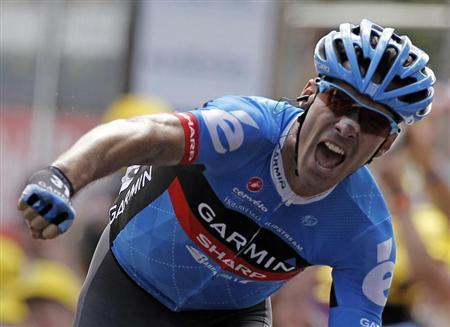 Garmin-Sharp rider David Millar of Britain reacts on the finish line as he wins the 12th stage of the 99th Tour de France cycling race between Saint-Jean-de-Maurienne and Annonay-Davezieux, July 13, 2012. REUTERS/Stephane Mahe