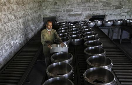 A worker arranges brake drums used in truck wheels at a steel factory in the outskirts of Coimbatore, about 500 km from Chennai, January 7, 2013. REUTERS/Babu