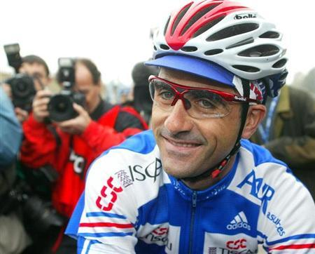 French cyclist Laurent Jalabert, one of the most successful riders of his generation, smiles ahead of the 2002 Cycling Road World Championships in Zolder October 13, 2002.