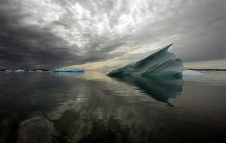 Icebergs float in the calm waters of a fjord, south of Tasiilaq in eastern Greenland August 4, 2009. REUTERS/Bob Strong