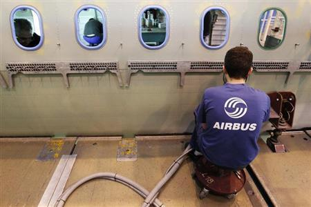 An Airbus employee works in a fuselage section of an A320 Airbus airplane at the Airbus facility in Montoir-de-Bretagne near Saint-Nazaire January 20, 2011. REUTERS/Stephane Mahe