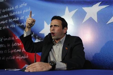 Henrique Capriles, Venezuela's opposition leader and governor of Miranda state, addresses the media in Caracas March 10, 2013. REUTERS/Carlos Garcia Rawlins