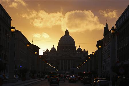 Saint Peter's Basilica at the Vatican is silhouetted during sunset in Rome, March 11, 2013. Roman Catholic Cardinals will begin their conclave inside the Vatican's Sistine Chapel Tuesday to elect a new pope. REUTERS/Paul Hanna