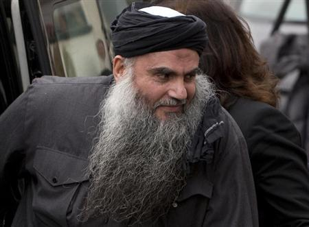 Radical Muslim cleric Abu Qatada is seen arriving back at his home after being released on bail, in London in this November 13, 2012 file photograph. REUTERS/Neil Hall/Files